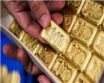 Gold eases on firm dollar, investors await clarity on trade spat